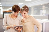 Businesswomen with digital tablet in office