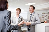 Smiling business people talking in office (thumbnail)