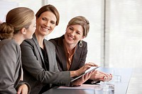 Smiling businesswomen using digital tablet