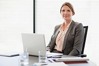 Portrait of smiling businesswoman with laptop