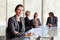 Portrait of confident businesswoman in conference room
