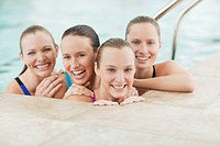 Portrait of smiling young women in swimming pool (thumbnail)