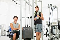 Portrait of smiling men working out in gymnasium