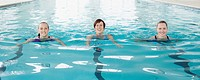 Portrait of smiling women swimming in swimming pool