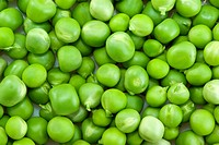 Pile of green peas of different sizes