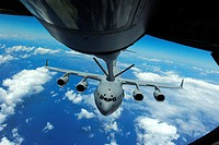 A C-17 Globemaster III prepares to connect to a KC-135 Stratotanker during an air refueling training mission over the Pacific on May 4, 2012  The miss...