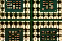 four green and gold computer processor chips
