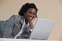 Jamaican businesswoman using a laptop