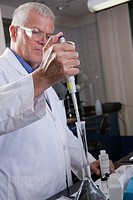 Environmental scientist injecting a precise volume of reference standard into a flask