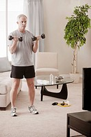 Caucasian man exercising in living room