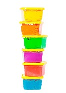 A stack of jars with plasticine of different colors