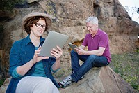 Caucasian couple using digital tablet in remote area