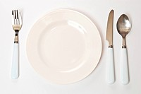 Set of kitchen object. The spoon, fork and knife with plate on a grey background.