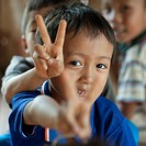 Close_up of Padaung boys showing V sign, Huay Pu Keng, Mae Hong Son Province, Thailand