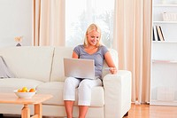 Calm woman shopping online in her living room