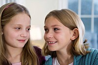 Close up of two girls smiling