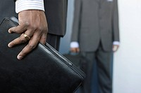 A young businessmen holding a folder