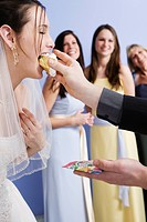 Side view of a bride eating cake