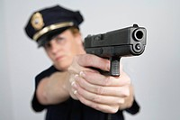 View of a police woman aiming with pistol