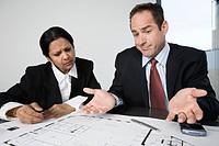 View of an architect discussing with a businesswoman