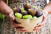 Italian chef Maddalena Caruso with a simple bowl filled with freshly picked figs ready to be used in one of her culinary creations