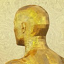 Back view of a golden metallic, faceted, engraved, textured and reflective human male head figure.