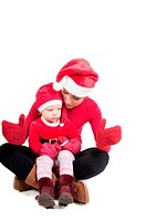 Santa mother and daughter in studio isolated