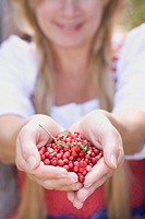 A woman holding lingonberries