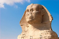 The Great Sphinx of Giza is a statue of a reclining lion with a human head that stands on the Giza Plateau on the west bank of the Nile, near modern_d...