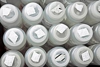 Plastic sample containers in laboratory, close_up