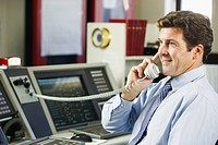 Operator talking on the telephone in a control room