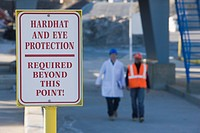 Warning sign saying Hardhat and Eye Protection Required Beyond This Point