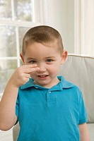 Boy signing the letter H in American Sign Language