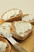 Bread,Cream cheese,Cutting board