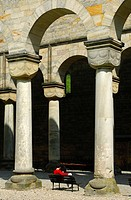 Visitors on the porch with round Romanesque columns, ruins of the Paulinzella Benedictine Monastery, Rottenbachtal, Thuringia, Germany, Europe