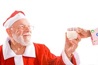 Santa getting a glass of milk from a woman´s hand. Isolated on white.