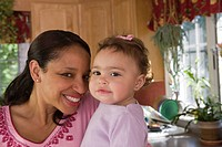 Hispanic woman smiling with her daughter