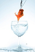 goldenfish in glass and watrer drip