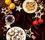 Christmas cakes and biscuits, punch and toffee apples forming a frame