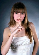 picture of lovely woman with finger on lips