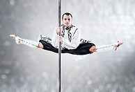 Young pole dance man. White colors.