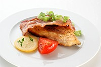grilled carp steak organic tomato and lemon