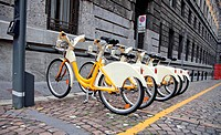 Row of bicycles for rent in Milano, Italy