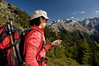 Hiker using GPS, Dolomites, South Tyrol, Italy