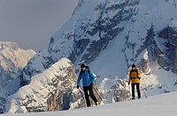 Two ski mountaineers in the Dolomites in winter, Italy