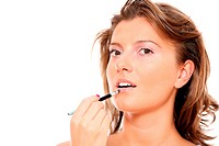 A close_up of a beautiful woman putting on makeup over white background, a lot of space for text