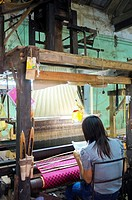 Woman working at loom, silk factory, Hanoi, Vietnam