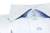 picture of a nicly folded men shirt with focus on the collars