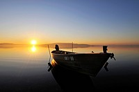Sunset with a fishing boat on the shore of the island of Reichenau, Konstanz district, Baden_Wuerttemberg, Germany, Europe