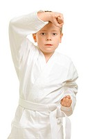 Karate boy defending head blocking strike photo over white